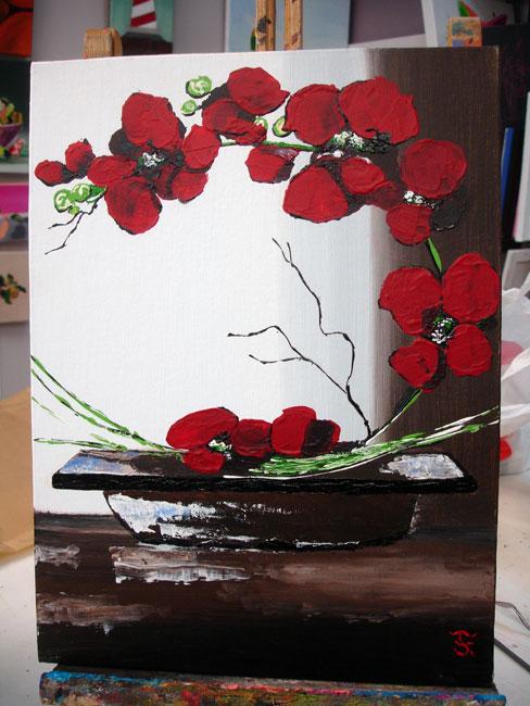 orchidée rouge dans un pot marron