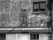 photo villes facade : Couple sur mur