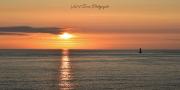 photo marine phare du four porspoder mer iroise : couchant sur le phare du Four