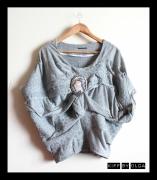 art textile mode architecture drapes leopard volume confortable : Top sweat en jaquard léopard et jersey orné de cristal Swarovski