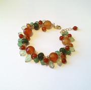 bijoux bracelet grappe pier : bracelet grappe orange vert, pierres Agate mousse et cornaline