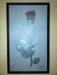 Rose sur lit de sable
