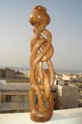 sculpture abstrait sourire content salade mange : L ESCALADE