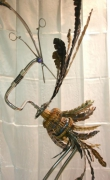 sculpture animaux oiseaux metal sculpture bois : L'oiseau à berceau