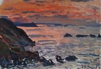 Ciel rouge et falaise au loin