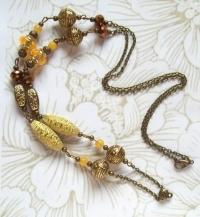 Chaîne fantaisie bohème perles jaunes ivoire et dorées